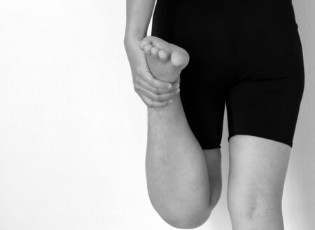 restore energy flow: Foot Pain and Legs of Woman, black and white tone
