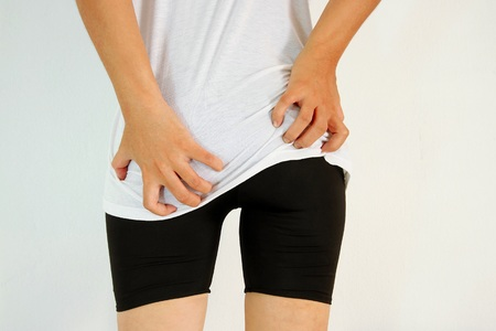 anal: Young woman has itching the buttocks, Healthcare concept.