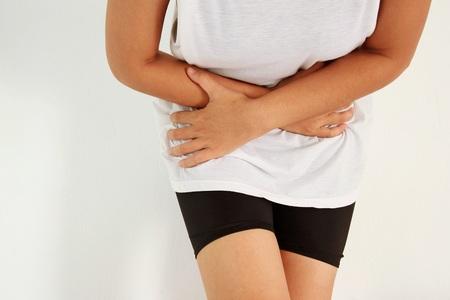 gastritis: woman stomach ache because of gastritis or menstruation