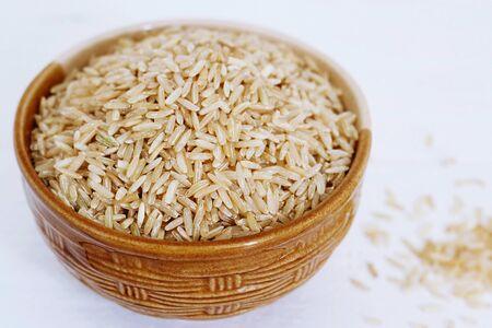 healt: Brown Rice on white background