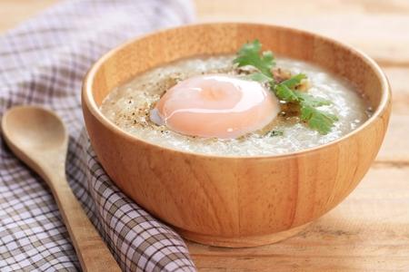 Pork rice porridge in wood bowl Stock Photo