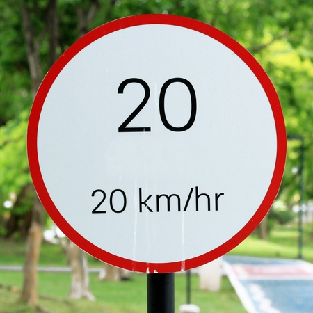 speed limit sign 20 on road in the park Stock Photo