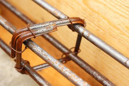 Steel Bars Construction Materials in Wooden Block Stock Photo
