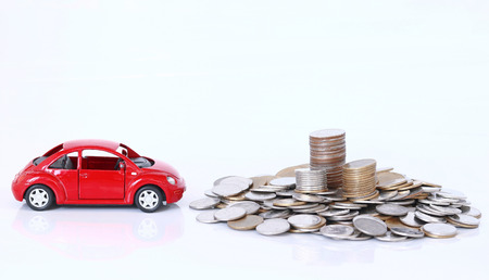 Money and red car on white background, business insurance concept Still-life
