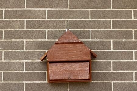 Old wood post box on wall