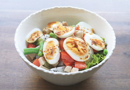 Diet menu. Healthy salad of fresh vegetables and egg on a bowl