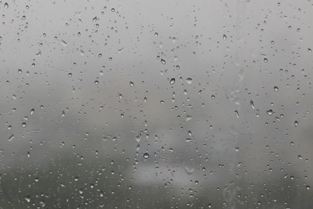 Rain water drops on blue Stock Photo