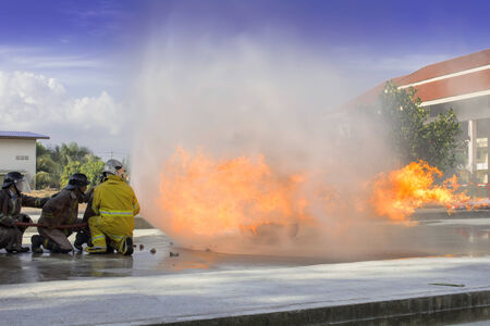 Firefighters fighting fire during training Stock Photo - 25043541