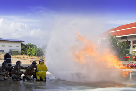 Firefighters fighting fire during training Stock Photo - 25043542