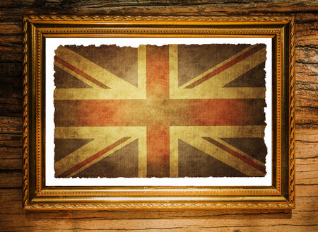 Union jack flag in Picture frame on the wooden wall photo