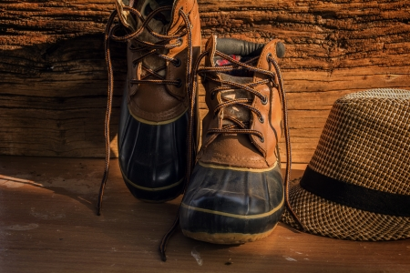A pair of leather hiking boots on wooden floor photo