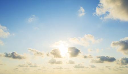 the sun's rays illuminate the sky above the horizon Stock fotó