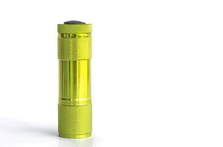 Green metal LED flashlight 0n white background
