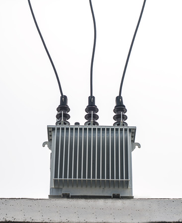 transformator: Three phase transformer on concrete platform on white background