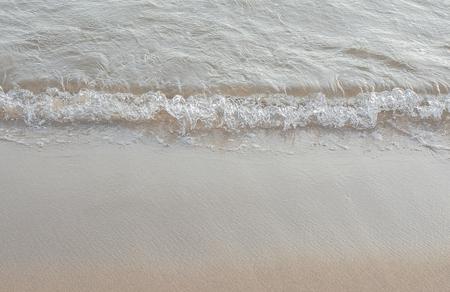 Soft wave of the sea on the sandy beach Stock fotó