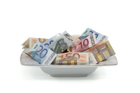 Salad bowl full of euro notes of different values photo