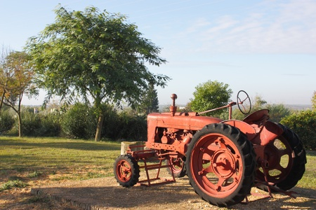 Old red tractor used for agricultural work in the decade of the '60s