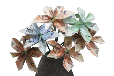 Bouquet of flowers origami made by bills of different values of euro. photo