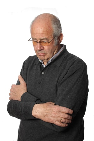 Elderly man shows sad and helpless on a white background photo