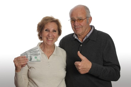 Elderly couple showing happy with money bills several hundred dollars photo