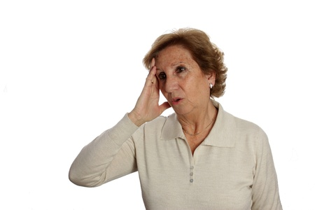 Elderly woman with a headache rubs her temples to ease your pain photo