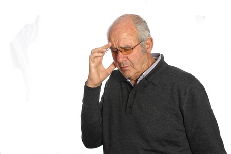 Elderly man with a headache rubs her temples to ease your pain Stock Photo - 13328232