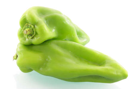 first plane: The first plane of two green natural peppers