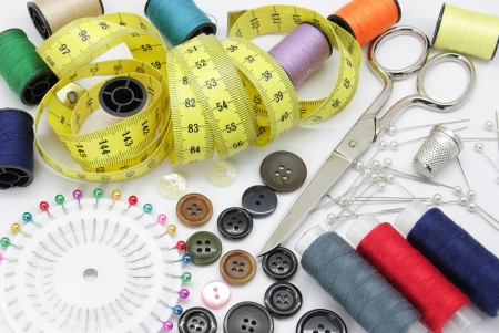 Different tools used for making arrangements in apparel sewing photo