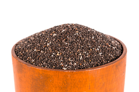 chia seed: Close-up of chia seed in wooden bowl.