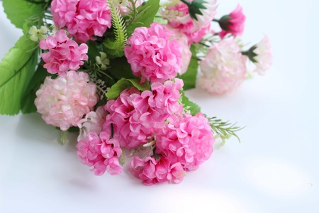 compiler: close up of artificial flowers bouquet arrange for decoration in home