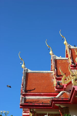 thai temple roof with king of nagas decoration photo
