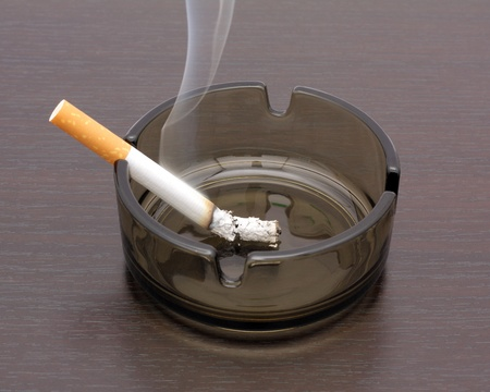 impotence:  Cigarette in an ashtray Stock Photo