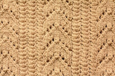 Brown knitted woolen background photo