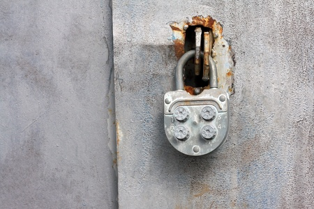 Combination lock on an old iron door photo