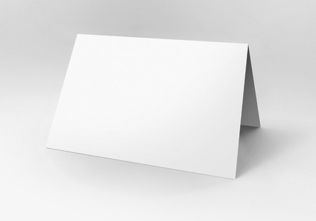 Blank folded card over a white background