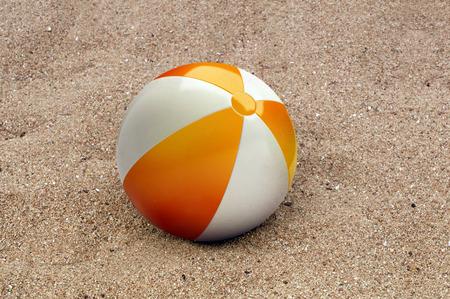 beachball: Beachball in the sand on the beach. Stock Photo