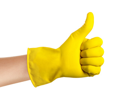 latex glove: Hand with yellow glove isolated on a white background. Stock Photo