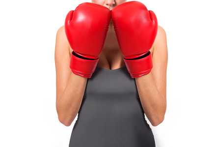 Woman with boxing gloves ready to fight.