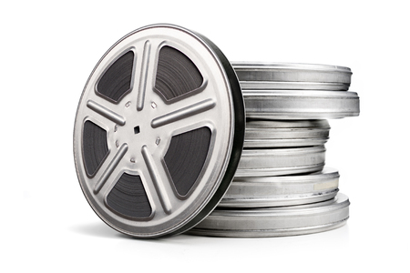 filmmaker: Movie canisters isolated on a white background. Pile of film reel cans.
