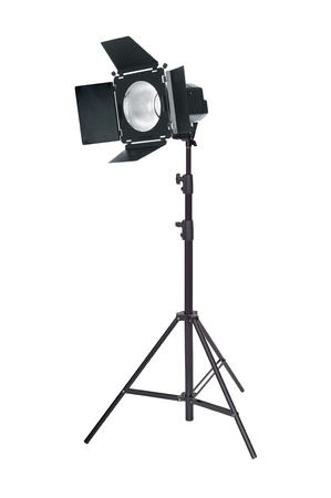 Studio lighting on a tripod stand, isolated on a white background. Spot light photography equipment.