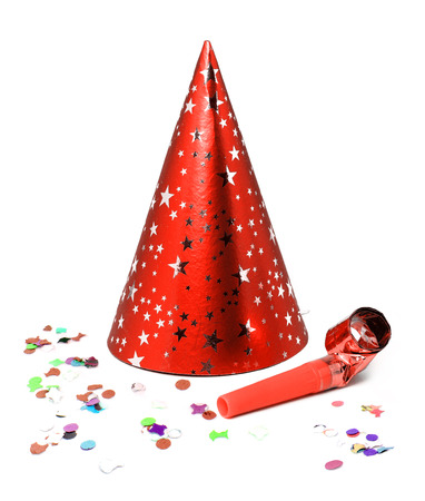 Party hat with confetti and blower whistle. Archivio Fotografico