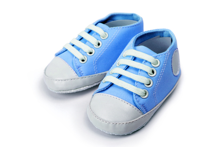 Blue baby boy shoes isolated over a white background Archivio Fotografico