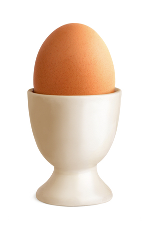 Egg in cup isolated over a white background.