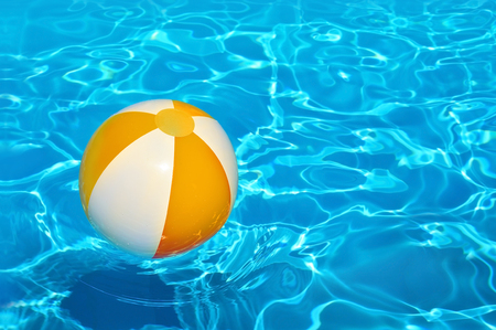 Blue swimming pool water background.