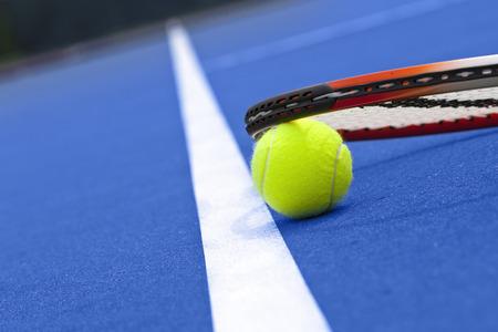 Tennis racket and ball. Sports equipment.
