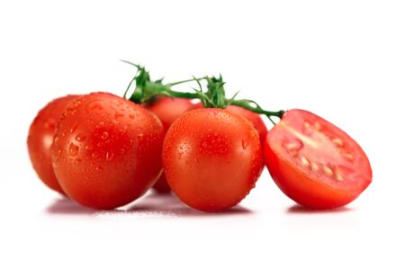 Fresh tomatoes isolated over a white background.