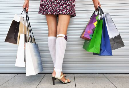 Girl with a bunch of shopping bags photo