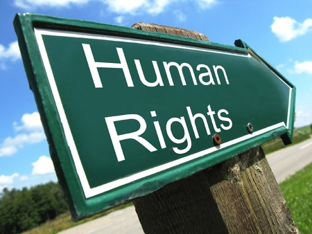 active arrow: HUMAN RIGHTS road sign