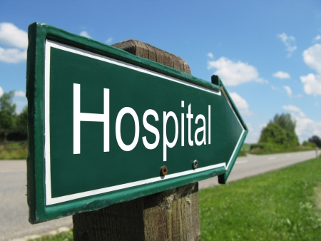 rural road: HOSPITAL road sign Stock Photo