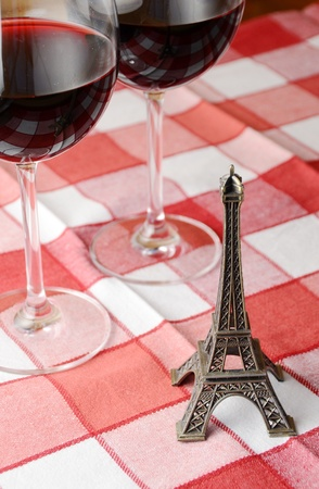 Souvenir Eiffel towe and a pair of wineglasses on the table photo